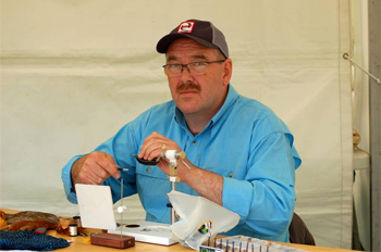 Peter McCallum tying barbless flies at the Scottish Game Fair